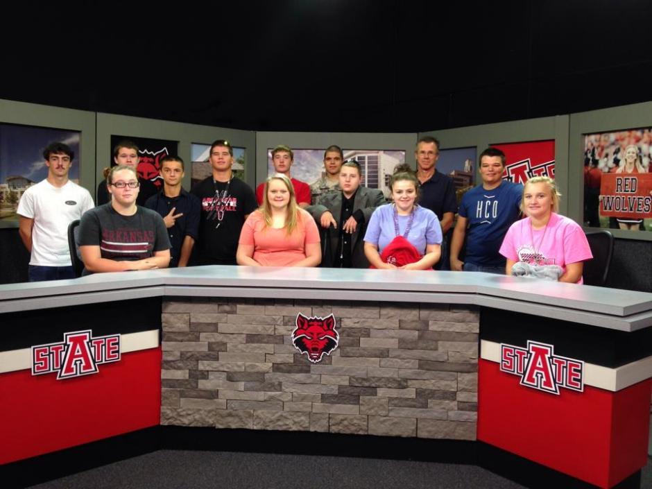 Students behind news desk